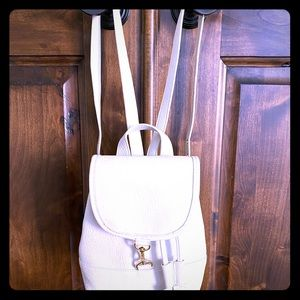 Free People creamy mini backpack.